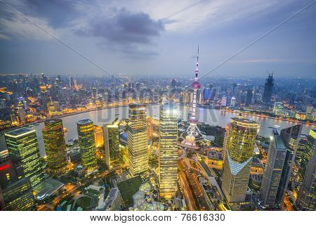 Shanghai, China city skyline viewed from above the Pudong Financial District.