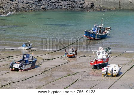 Fishing Boats Pulled Up Port Isaac Harbour Waiting For The tide
