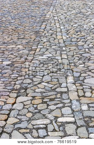 Cobbled Or Stone Paved Road Creating A Geometric Pattern From The Stones