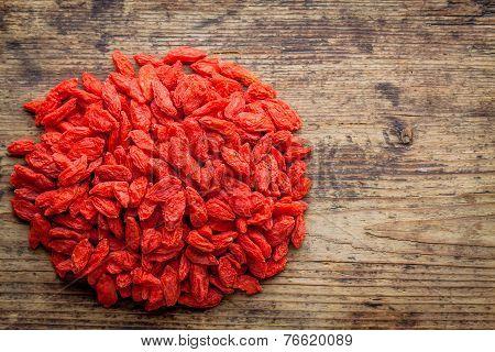 Dried Goji Berries On A Wooden Background
