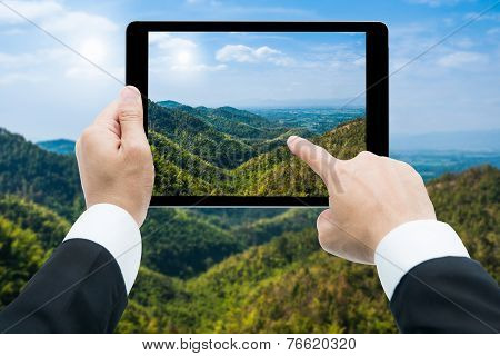 Businessman Hands Tablet Taking Pictures Mountains And Blue Sky