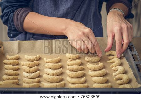 Cook Preparing Traditional Crescent Biscuits