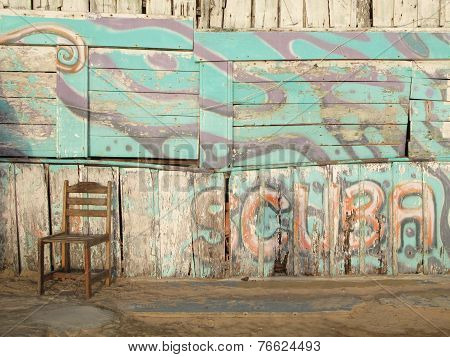 Rusty Wooden Facade With Scuba Diving Logo