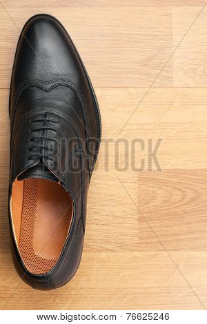 Classic Mens Shoes Stand On The Wooden Floor
