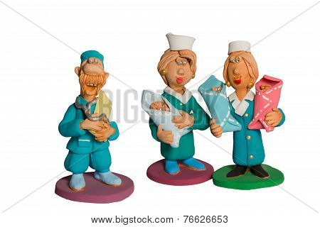Statuette of doctors with three babies in their arms