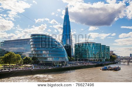 LONDON, UK - AUGUST 16, 2014: Shard of glass on river Thames South bank walk.