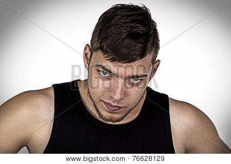 Photo of young man looking at camera