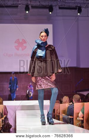 NOVOSIBIRSK, RUSSIA - NOVEMBER 15, 2014: Model dressed from Olga Buzytskaya on the Grand defile of Novosibirsk Fashion Week. The event was held under the motto High Fashion & High Classics