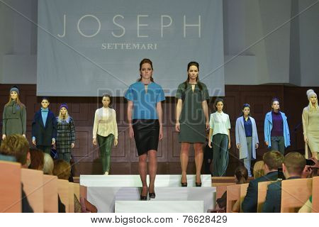 NOVOSIBIRSK, RUSSIA - NOVEMBER 15, 2014: Models dressed from Joseph collection on the Grand defile of Novosibirsk Fashion Week. The event was held under the motto High Fashion & High Classics