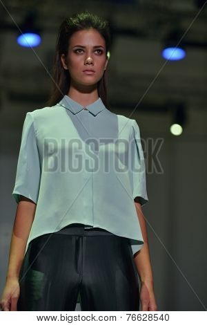 NOVOSIBIRSK, RUSSIA - NOVEMBER 15, 2014: Model dressed from Joseph collection on the Grand defile of Novosibirsk Fashion Week. The event was held under the motto High Fashion & High Classics
