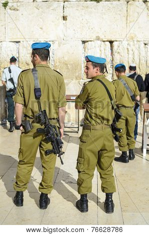 JERUSALEM, ISRAEL - FEBRUARY 23, 2012: Israeli Soldiers stand guard at the Western Wall.