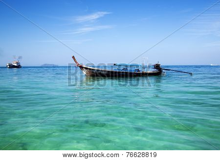 Longtail boat in Krabi, Thailand - exotic beach holiday background