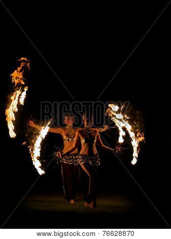 BALI, INDONESIA - NOVEMBER 20, 2014: Two Fire dancer with traditionnal costume , BALI, INDONESIA on NOVEMBER 20, 2014