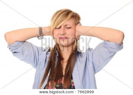 Young Teenage Girl Covering Ears