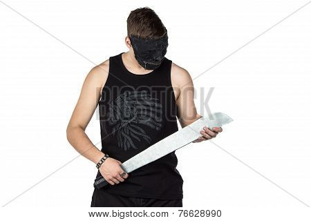 Image of young man in mask with hatchet