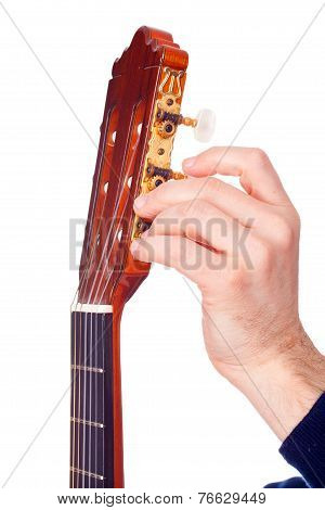 Person Tuning A Guitar From Its Headstock Over White Background 2