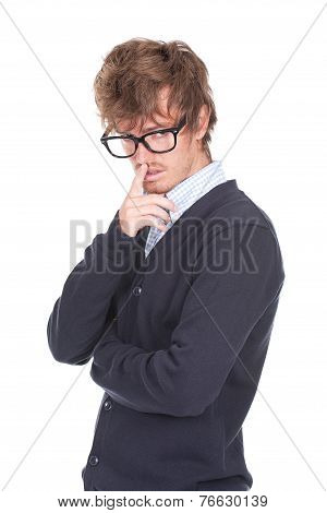 Man With Glasses And Finger Over The Mouth