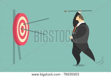 Businessman Trying To Hit A Target With A Spear