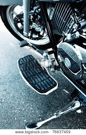 Detail with the foot-rest of motorcycle