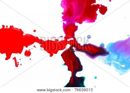 Spilled multicoloured paint isolated on white