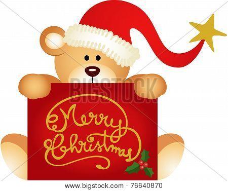 Christmas teddy bear holding a Merry Christmas