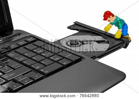 Toy Man Repairing A Laptop