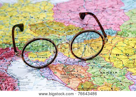 Glasses on a map of europe - Slovenia
