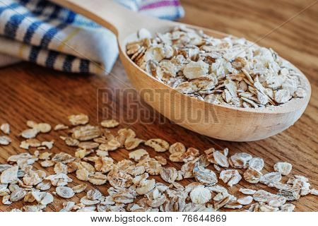 Oat Flakes In Wooden Spoon
