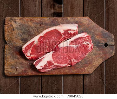 Raw Meat On Wooden Table.