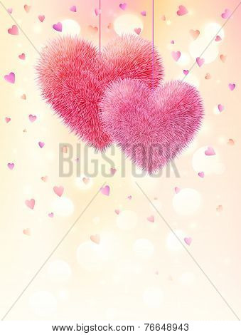 Pink fluffy hearts pair on light bokeh background