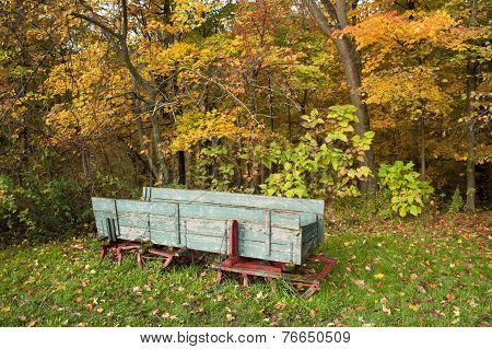 Old Wooden Sleigh In Woods.