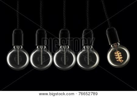 Vintage style lightbulbs doing the Newton Cradle