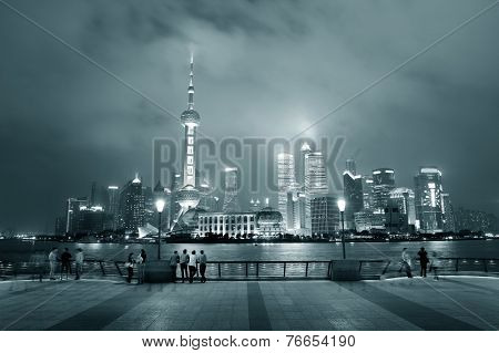 Shanghai urban city skyline over walkway at night in black and white