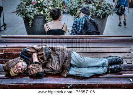 Homeless Senior Man Sleeping On Park Bench