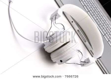 White Headphones And Laptop.