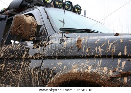 Muddy Sport Utility Vehicle.