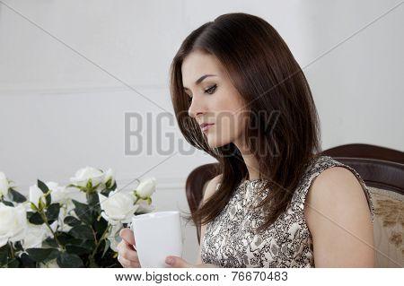 Brunette Girl. Drinking Coffee Tea
