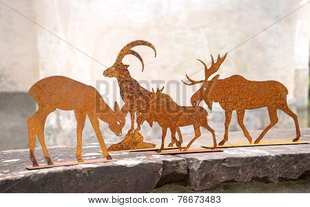 Deer, steinbock and moose made of metal