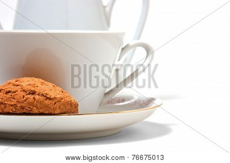Cup On A Saucer And Biscuits