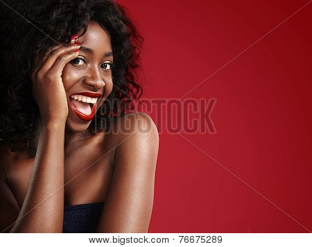 Laughing Black Woman On A Red Background