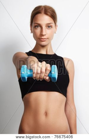 Woman Holding Barbell Towards The Camera
