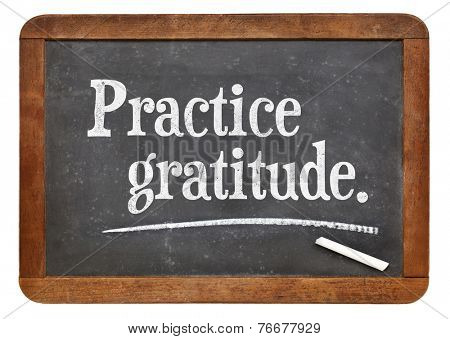 practice gratitude - advice or reminder on a vintage slate blackboard
