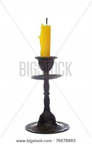 Old Yellow Candle In Old Bronze Candlestick