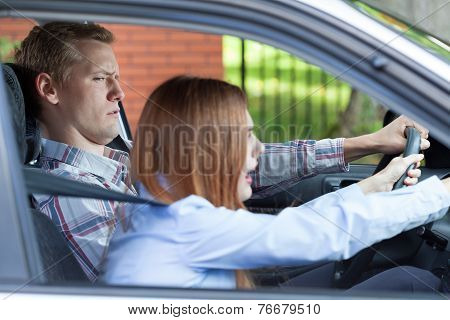 Young Couple Arguing While Driving