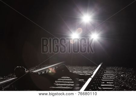 Woman Lying On The Railway Tracks