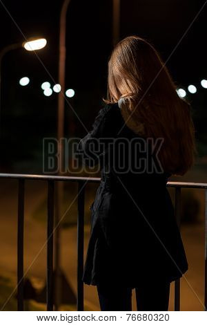 Girl Standing On A Viaduct