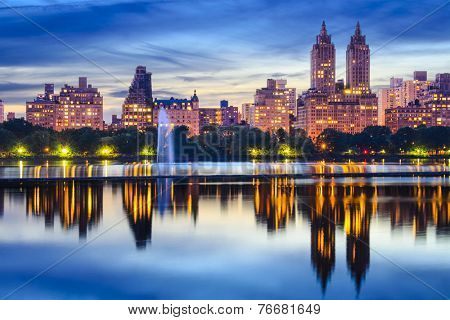 New York City, USA cityscape at Central Park Lake.