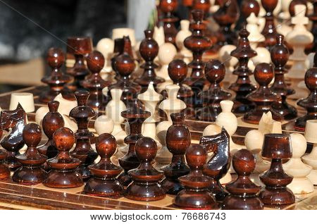 Black and white chess pieces on a chessboard, closeup. Set of chess figures on the playing board