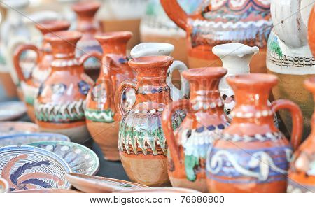 Romanian traditional pottery handcrafted mugs at a souvenir shop. Romanian traditional handcraft