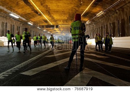 Runners In The Tunnel Run And A Photographer
